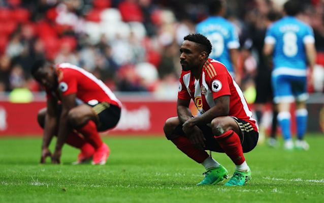 <span>Jermain Defoe on his haunches after the full-time whistle</span> <span>Credit: Getty Images </span>