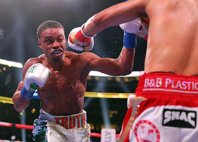 Errol Spence Jr. (L) dominates Mikey Garcia (R) in an IBF welterweight championship fight on March 16, 2019, in Arlington, Texas. (AP Photo)