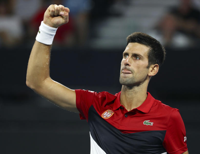 Novak Djokovic of Serbia reacts after winning the first set during his match against Kevin Anderson of South Africa at the ATP Cup tennis tournament in Brisbane, Australia, Saturday, Jan. 4, 2020. (AP Photo/Tertius Pickard)