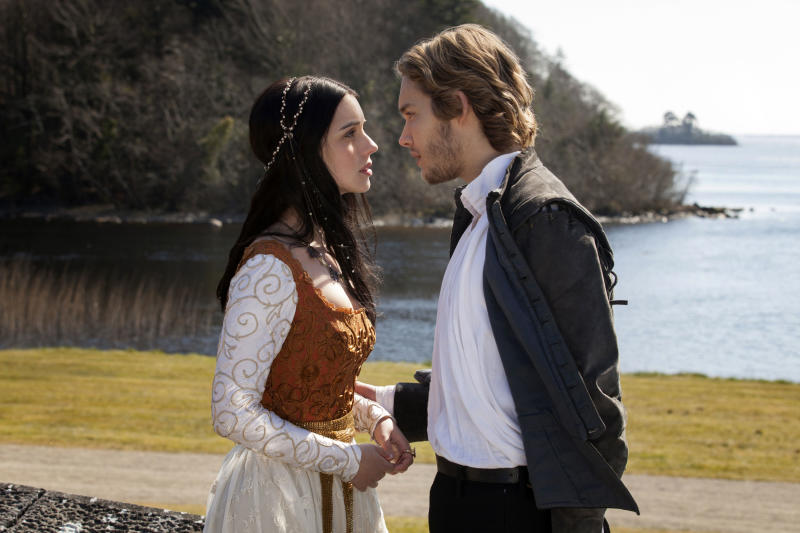 """This publicity image released by The CW shows Adelaide Kane as Mary, Queen of Scots, left, and Toby Regbo as Prince Francis in the pilot episode of """"Reign,"""" premiering Oct. 17 at 9 p.m. EST on the CW network. (AP PhotoThe CW, Joss Barratt)"""