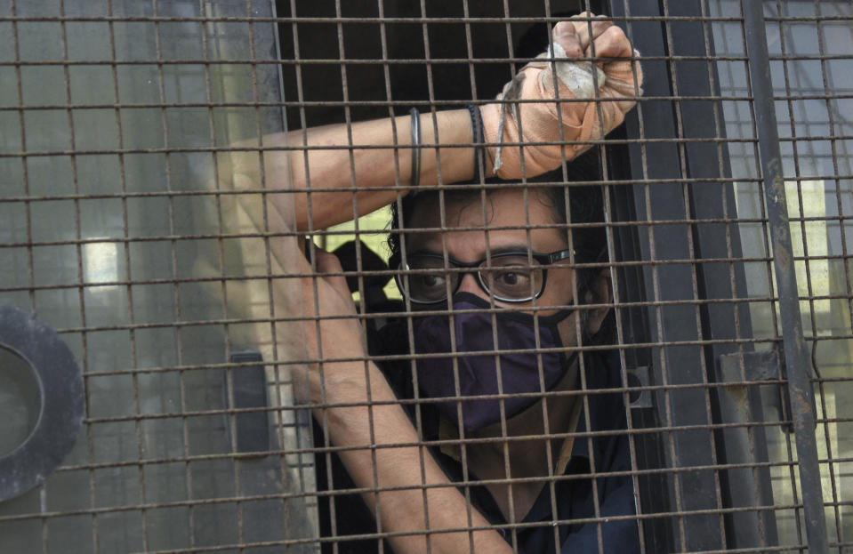 Arnab Goswami sits inside a police vehicle after he was produced in a court following his arrest in Mumbai, India, Wednesday, Nov. 4, 2020. (AP Photo)