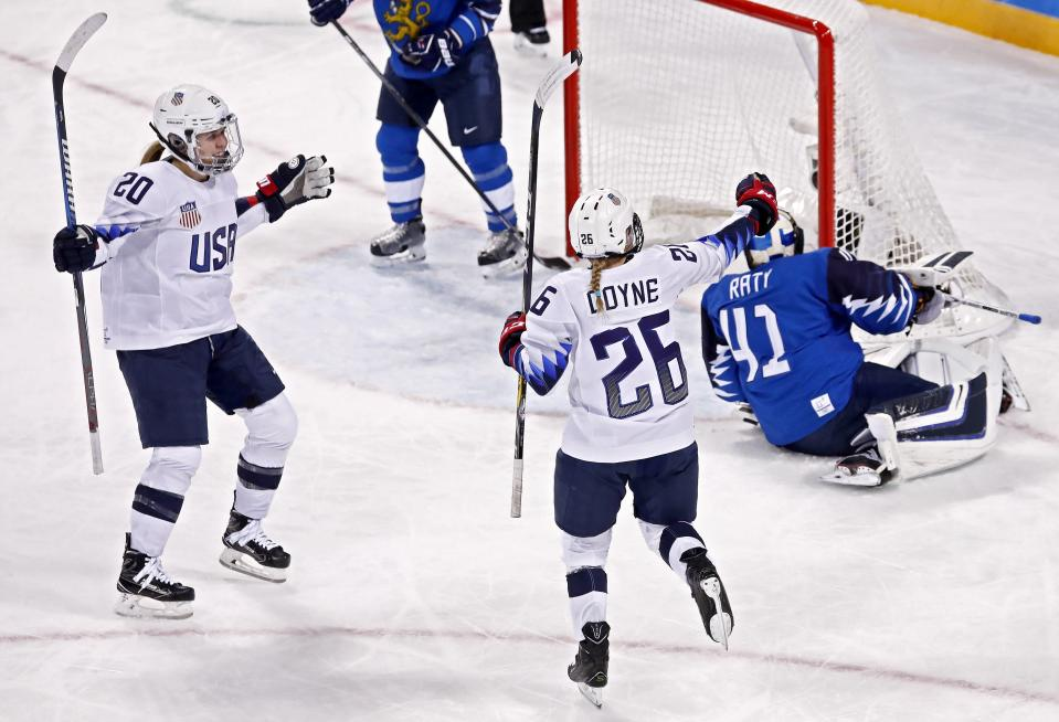 Kendall Coyne (C) of the USA celebrates after scoring a goal in the second period of the Americans' win over Finland on Sunday. (AP)