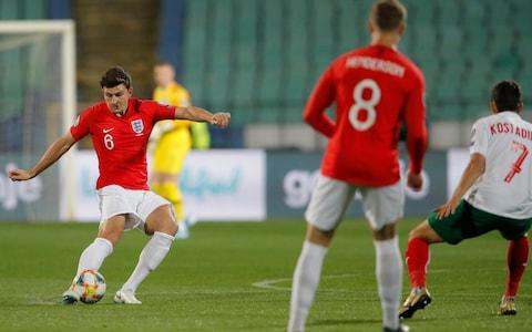<span>England's Harry Maguire, left, with a pass</span> <span>Credit: AP Photo/Vadim Ghirda </span>