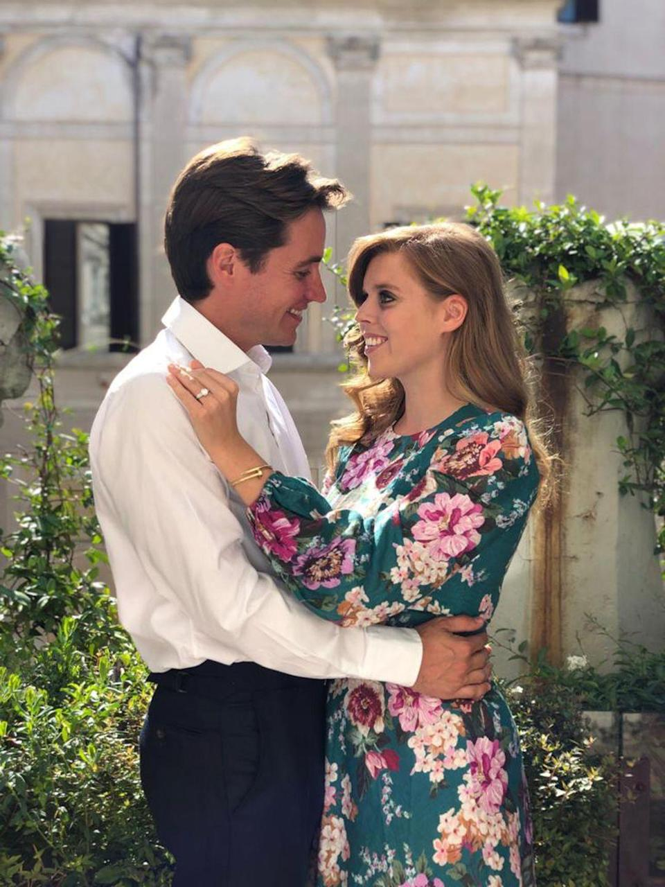 """<p>The couple <a href=""""https://www.townandcountrymag.com/society/tradition/a28861655/princess-beatrice-engaged-edoardo-mapelli-mozzi/"""" rel=""""nofollow noopener"""" target=""""_blank"""" data-ylk=""""slk:announced their official engagement"""" class=""""link rapid-noclick-resp"""">announced their official engagement</a> with beautiful photos taken by Princess Eugenie. Here they are looking into each other's eyes.</p>"""