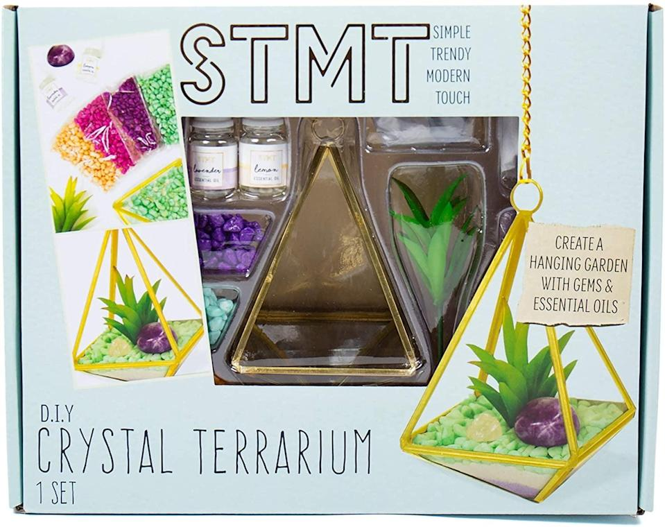 """<p>They can create their very own plant to hang with this creative <a href=""""https://www.popsugar.com/buy/STMT-DIY-Crystal-Terrarium-569747?p_name=%20STMT%20DIY%20Crystal%20Terrarium&retailer=amazon.com&pid=569747&price=19&evar1=moms%3Aus&evar9=32519221&evar98=https%3A%2F%2Fwww.popsugar.com%2Ffamily%2Fphoto-gallery%2F32519221%2Fimage%2F44850632%2FSTMT-DIY-Crystal-Terrarium&list1=gifts%2Choliday%2Cgift%20guide%2Cgifts%20for%20kids%2Ckid%20shopping%2Ctweens%20and%20teens%2Cgifts%20for%20teens&prop13=api&pdata=1"""" class=""""link rapid-noclick-resp"""" rel=""""nofollow noopener"""" target=""""_blank"""" data-ylk=""""slk:STMT DIY Crystal Terrarium""""> STMT DIY Crystal Terrarium</a> ($19).</p>"""