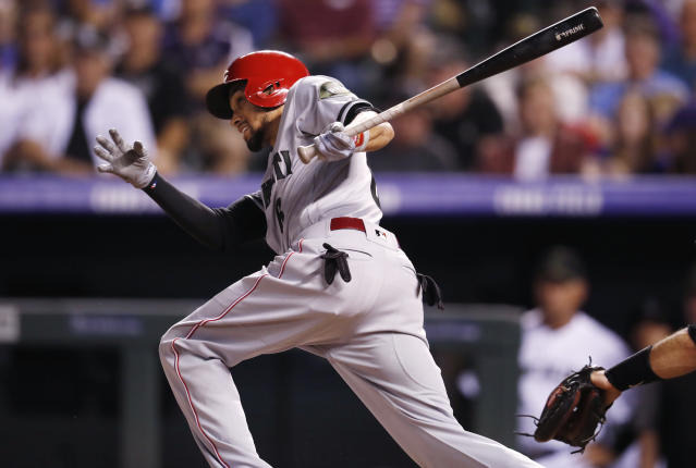 Cincinnati Reds' Billy Hamilton follows the flight of his RBI-triple off Colorado Rockies relief pitcher Chris Rusin in the seventh inning of a baseball game Saturday, May 26, 2018, in Denver. (AP Photo/David Zalubowski)