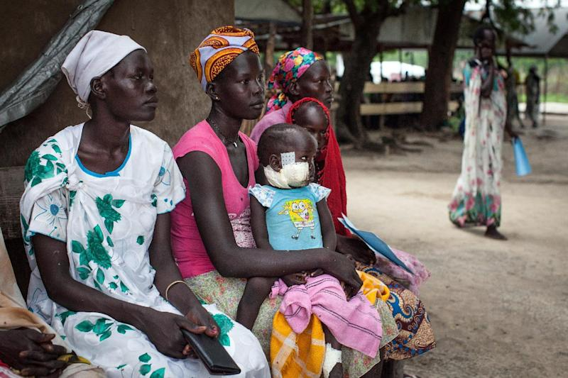 Families with malnourished children wait to receive treatment at the Leer Hospital run by Medecins Sans Frontieres on July 7, 2014 in South Sudan (AFP Photo/Nichole Sobecki)