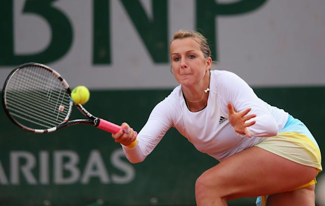 Anastasia Pavlyuchenkova of Russia plays a forehand in her Women's Singles match against Petra Cetkovska of Czech Republic during day four of the French Open at Roland Garros on May 29, 2013 in Paris, France. (Photo by Julian Finney/Getty Images)