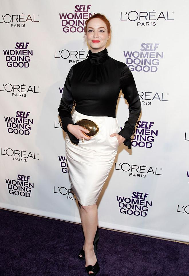 """After rocking an amazing cleavage-baring Vivienne Westwood gown the night before at the """"I Don't Know How She Does It"""" premiere, Christina Hendricks disappointed in this tucked-in turtleneck and skirt ensemble. What do you think of her red carpet outfit? Mark Von Holden/<a href=""""http://www.wireimage.com"""" target=""""new"""">WireImage.com</a> - September 13, 2011"""
