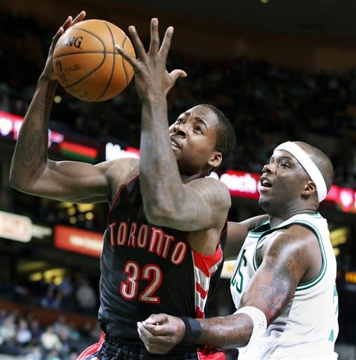 Toronto Raptors power forward Ed Davis (32) grabs a rebound in front of Boston Celtics center Jermaine O'Neal in the first quarter of an NBA basketball game in Boston, Wednesday, Jan. 18, 2012. (AP Photo/Elise Amendola)