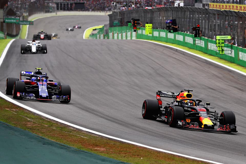 SAO PAULO, BRAZIL - NOVEMBER 11: Daniel Ricciardo of Australia driving the (3) Aston Martin Red Bull Racing RB14 TAG Heuer leads Pierre Gasly of France and Scuderia Toro Rosso driving the (10) Scuderia Toro Rosso STR13 Honda on track during the Formula One Grand Prix of Brazil at Autodromo Jose Carlos Pace on November 11, 2018 in Sao Paulo, Brazil.  (Photo by Mark Thompson/Getty Images)