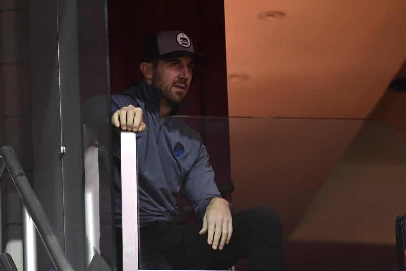 Washington Redskins quarterback Alex Smith sits in the stands during the game between the Washington Wizards and the Detroit Pistons at Capital One Arena. Mandatory Credit: Tommy Gilligan-USA TODAY Sports