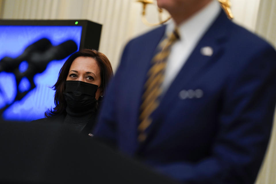 FILE - In this Jan. 22, 2021, file photo Vice President Kamala Harris listens as President Joe Biden delivers remarks on the economy in the State Dining Room of the White House in Washington. (AP Photo/Evan Vucci, File)