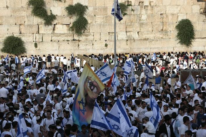 Israelis gather at the Western Wall in Jerusalem's old city on June 5, 2016 with their national flags as they celebrate the Jerusalem day which marks Israel's 1967 seizure of the Palestinian-dominated eastern half of Jerusalem (AFP Photo/Menahem Kahana)