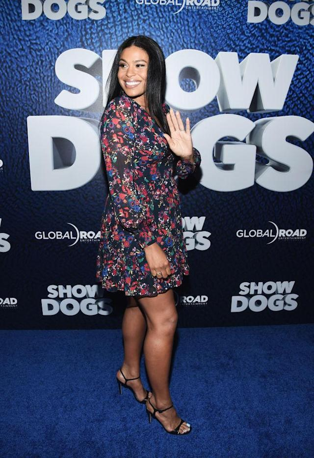 The star stunned in a floral mini dress and heels. (Photo: Getty Images)