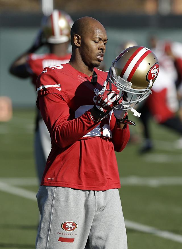 San Francisco 49ers cornerback Carlos Rogers adjusts his helmet during practice at an NFL football training facility in Santa Clara, Calif., Wednesday, Jan. 15, 2014. The 49ers are scheduled to play the Seattle Seahawks for the NFC Championship on Sunday. (AP Photo/Jeff Chiu)