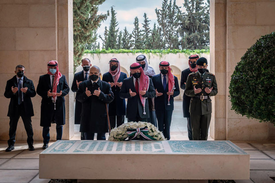 This photo from the Royal Court twitter account, shows Jordan's King Abdullah II, center, Prince Hamzah bin Al Hussein, second left, and others during a visit to the tomb of the late King Hussein, in Amman Jordan, Sunday, April 11, 2021. Abdullah II and his half brother Prince Hamzah have made their first joint public appearance since a palace feud last week. Members of the Jordanian royal family Sunday marked the centenary of the establishment of the Emirate of Transjordan, a British protectorate that preceded the kingdom. (Royal Court Twitter Account via AP)