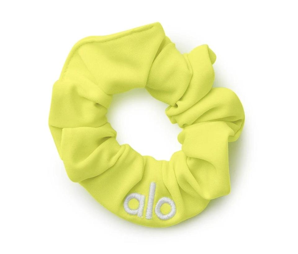 <p>Make a statement with the highlighter-hued <span>Alo Yoga Neon Scrunchie</span> ($12). It will keep the stray hairs out of your face and brighten your day.</p>