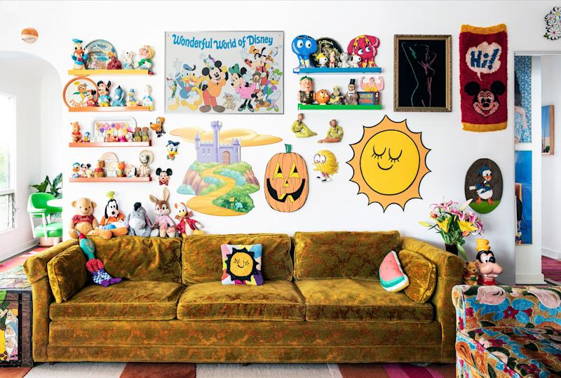 We love Lacey and Phillip's commitment to their Disney collection, on major display in their living room. Wood jack-o'-lantern and sun cutouts by Chris Uphues.