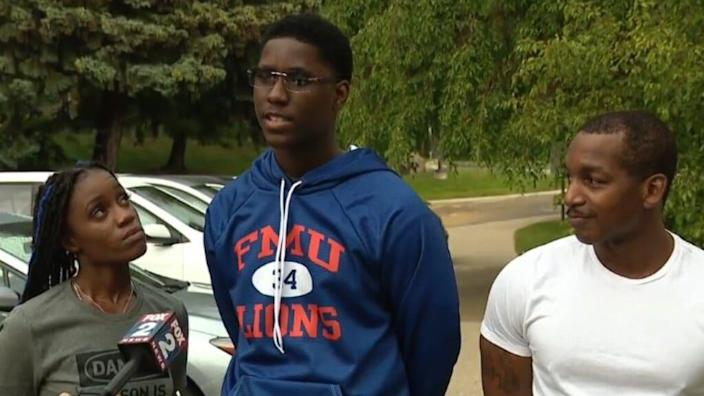 """Brennan Walker (center), shown with his mother, Lisa, and stepfather, Steven, chose a Florida HBCU """"because I feel like I know a lot of people here — and I want to be surrounded by new people."""" (Fox 2 Detroit. )"""