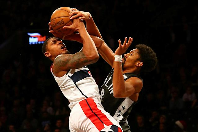 Dec 22, 2017; Brooklyn, NY, USA; Brooklyn Nets guard Spencer Dinwiddie (8) blocks a shot by Washington Wizards guard Bradley Beal (3) during the first half at Barclays Center. Mandatory Credit: Andy Marlin-USA TODAY Sports TPX IMAGES OF THE DAY