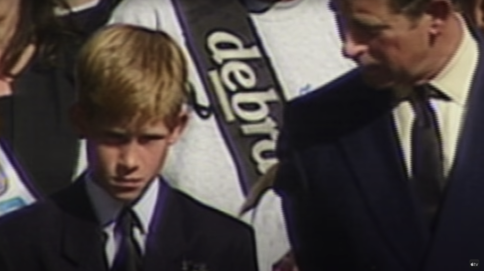 Prince Harry and Prince Charles are seen at Princess Diana's funeral