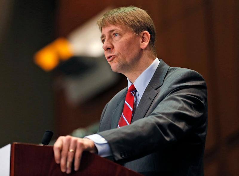 FILE - In this March 26, 2015, file photo, Consumer Financial Protection Bureau Director Richard Cordray speaks during a panel discussion in Richmond, Va. The Consumer Financial Protection Bureau has proposed a massive overhaul of the multibillion dollar debt-collection industry. The changes released Thursday, July 28, 2016, would restrict collectors from calling numerous times a day, require them to more substantially prove a debt is valid, and give people more ability to dispute their bills. The CFPB is also proposing a 30-day waiting period on collection attempts for loans tied to a person who has recently died. (AP Photo/Steve Helber, File)
