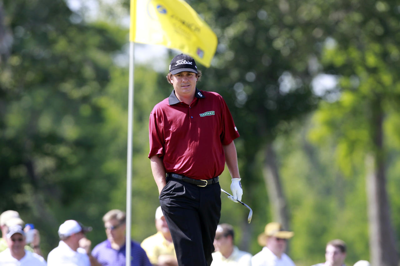 Jason Dufner walks to the pin during the second round of the Zurich Classic golf tournament at TPC Louisiana in Avondale, La., Friday, April 27, 2012. (AP Photo/Gerald Herbert)