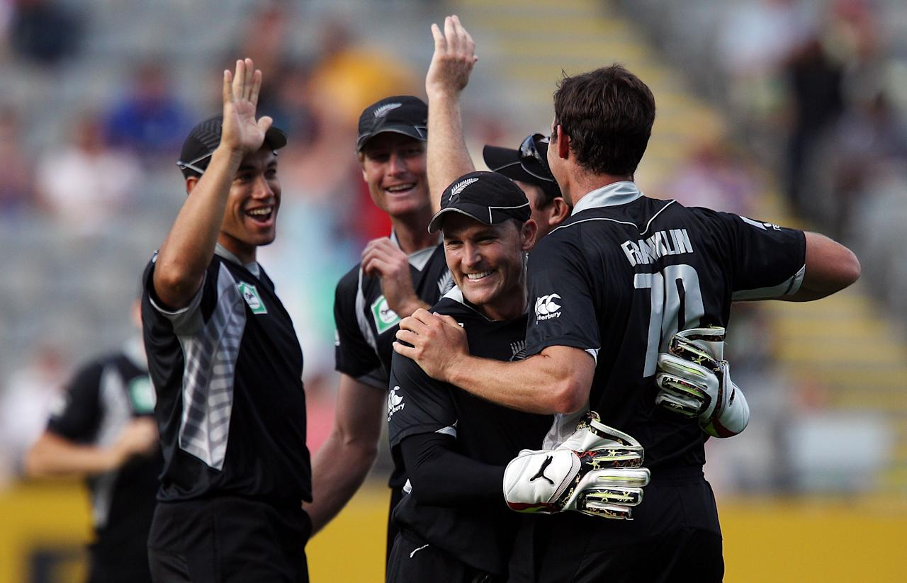 AUCKLAND, NEW ZEALAND - FEBRUARY 05:  L to R, Ross Taylor, Martin Guptill, Brendon McCullum and James Franklin of the Black Caps celebrate after taking a wicket during game six of the one day series between New Zealand and Pakistan at Eden Park on February 5, 2011 in Auckland, New Zealand.  (Photo by Hagen Hopkins/Getty Images)