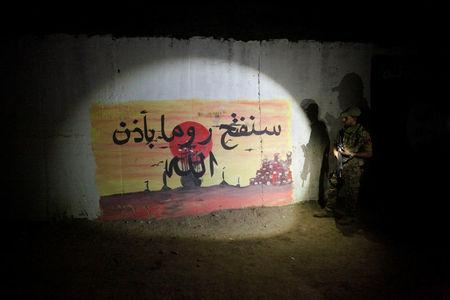 "A view of Islamic State slogans painted along the walls of the tunnel that was used by Islamic State militants as an underground training camp in the hillside overlooking Mosul, Iraq. The slogan reads, ""We will conquer Roma God willing"".   REUTERS/Alaa Al-Marjani"