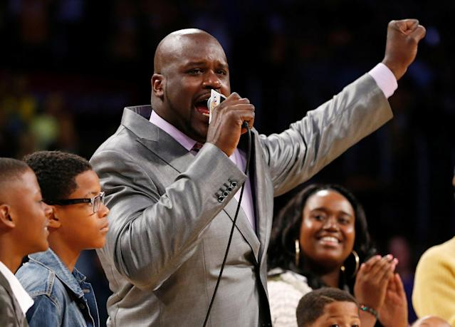 FILE PHOTO: Former Los Angeles Lakers' Shaquille O'Neal gestures as he speaks during a ceremony to retire jersey #34 in honor of O'Neal during halftime of the NBA basketball game against the Dallas Mavericks in Los Angeles, California, U.S., April 2, 2013. REUTERS/Danny Moloshok/File Photo