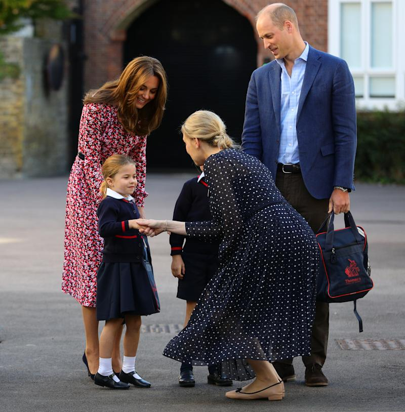 LONDON, UNITED KINGDOM - SEPTEMBER 5: Helen Haslem, head of the lower school greets Princess Charlotte as she arrives for her first day of school, with her brother Prince George (hidden) and her parents the Duke and Duchess of Cambridge, at Thomas's Battersea in London on September 5, 2019 in London, England. (Photo by Aaron Chown - WPA Pool/Getty Images)
