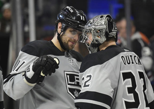 Los Angeles Kings center Anze Kopitar, left, and goaltender Jonathan Quick congratulate each other after an NHL hockey game against the Edmonton Oilers, Saturday, Jan. 5, 2019, in Los Angeles. The Kings won 4-0. (AP Photo/Mark J. Terrill)