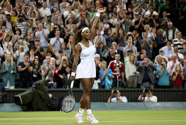 LONDON, ENGLAND - JUNE 29: Serena Williams of the United States of America celebrates match point during the Ladies' Singles third round match against Kimiko Date-Krumm of Japan on day six of the Wimbledon Lawn Tennis Championships at the All England Lawn Tennis and Croquet Club on June 29, 2013 in London, England. (Photo by Clive Brunskill/Getty Images)