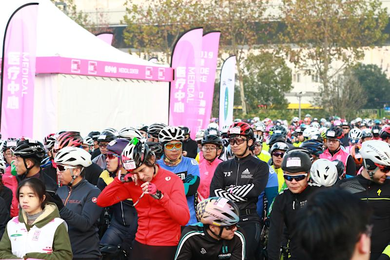Riders wait patiently for the start of the race