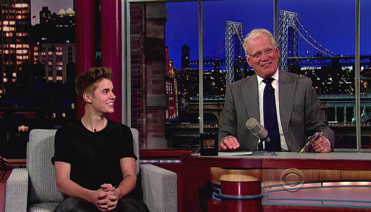 Justin Bieber promotes his new album 'Believe' and mentions the new tattoo he got on his arm, which Letterman objected to, during an appearance on CBS's 'Late Show With David Letterman' USA - 21.06.12  Supplied by WENN.com  WENN does not claim any ownership including but not limited to Copyright or License in the attached material. Any downloading fees charged by WENN are for WENN's services only, and do not, nor are they intended to, convey to the user any ownership of Copyright or License in the material. By publishing this material you expressly agree to indemnify and to hold WENN and its directors, shareholders and employees harmless from any loss, claims, damages, demands, expenses (including legal fees), or any causes of action or  allegation against WENN arising out of or connected in any way with publication of the material.