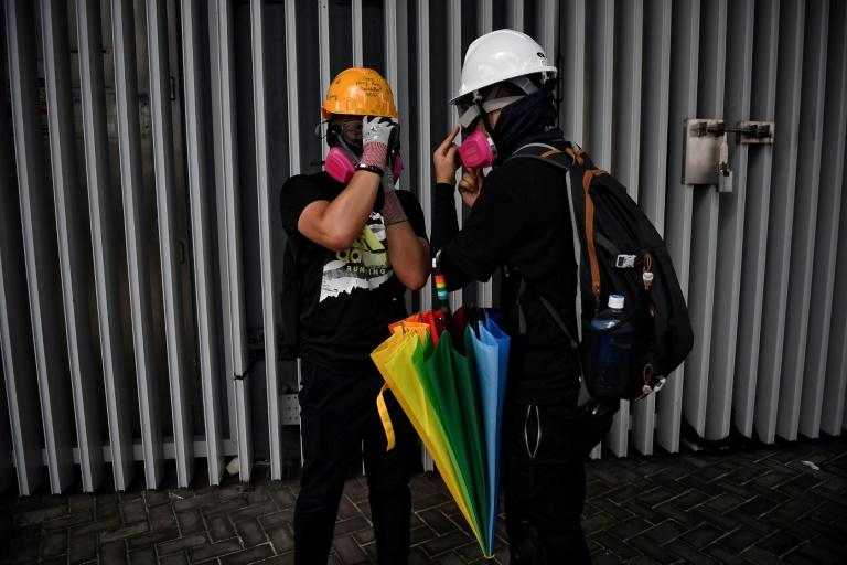 Hong Kong protesters who throw petrol bombs are known as 'wizards' while teams who extinguish tear gas canisters are dubbed 'firefighters'
