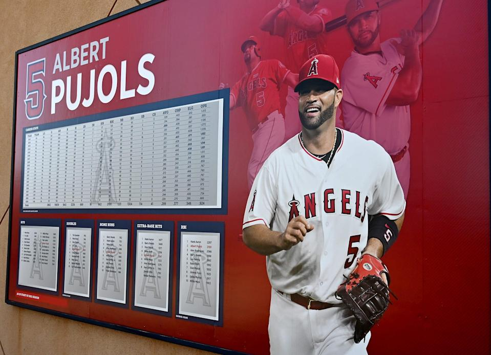 Career stats of Albert Pujols are displayed near an entrance to Angel Stadium.