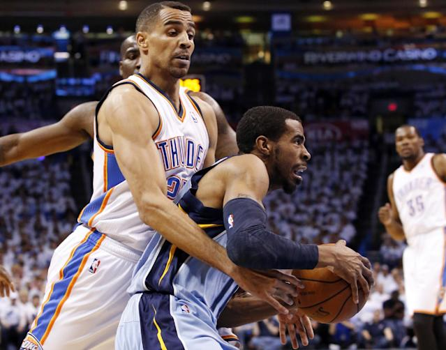 Memphis Grizzlies guard Mike Conley, right, drives around Oklahoma City Thunder guard Thabo Sefolosha in the first quarter of Game 5 of an opening-round NBA basketball playoff series in Oklahoma City, Tuesday, April 29, 2014. (AP Photo)
