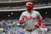 Philadelphia Phillies Rhys Hoskins heads to the dugout after hitting a two run home run in the first inning of a baseball game against the New York Mets, Sunday, Sept. 9, 2018, in New York. (AP Photo/Mark Lennihan)