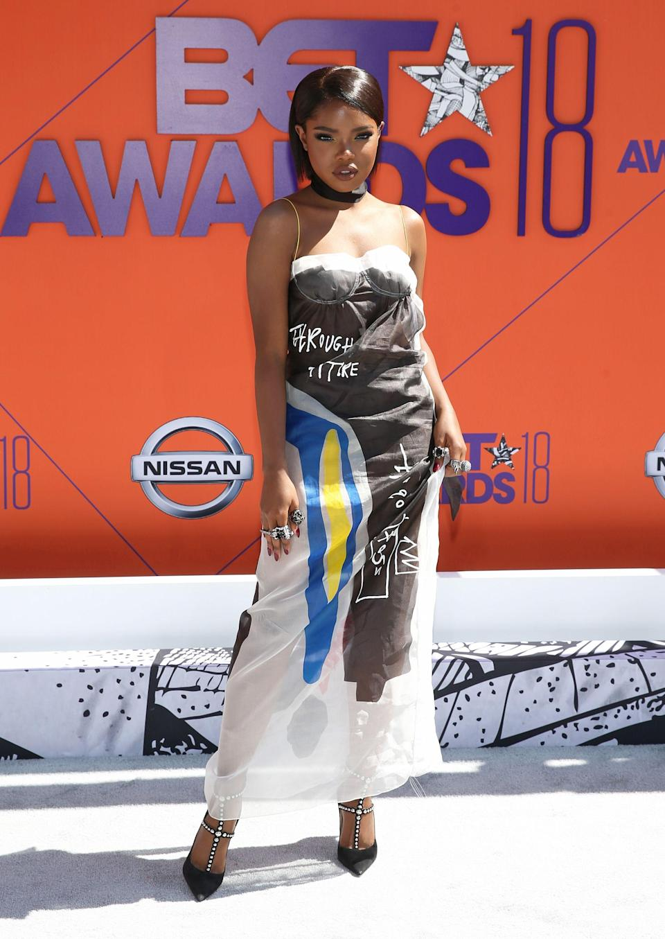 "<p><em>Star</em> actress Ryan Destiny stuns in this Hugo printed slip dress. And those shoes aren't too shabby either.</p><span class=""copyright"">Photo: Bennett Raglin/Getty Images.</span>"