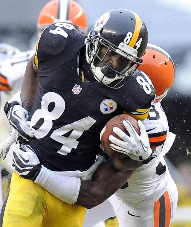 Pittsburgh Steelers wide receiver Antonio Brown (84) tries to break through a tackle by Cleveland Browns defensive back Julian Posey in the third quarter of an NFL football game on Sunday, Dec. 29, 2013, in Pittsburgh. The Steelers won 20-7. (AP Photo/Don Wright)