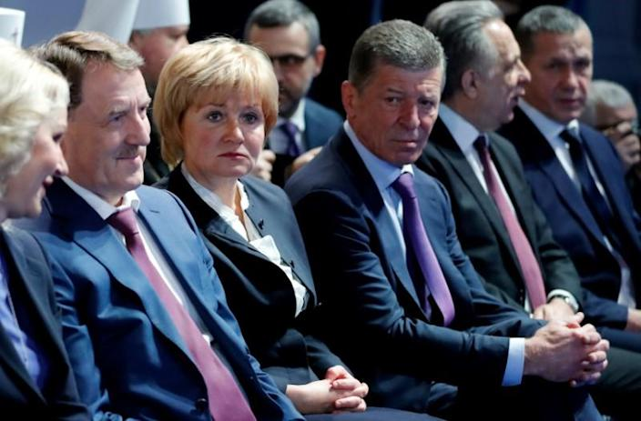 Officials gather before Russian President Putin's annual address to the Federal Assembly in Moscow