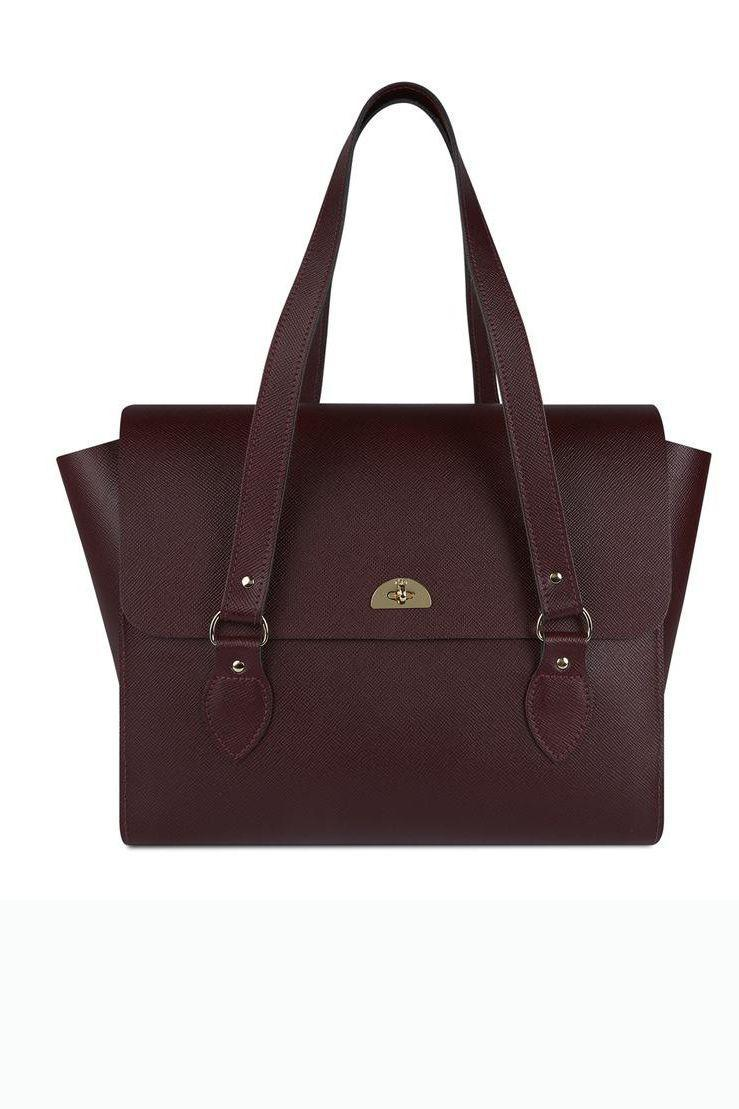 """<p><a class=""""link rapid-noclick-resp"""" href=""""https://go.redirectingat.com?id=127X1599956&url=https%3A%2F%2Fwww.cambridgesatchel.com%2Fproducts%2Fthe-emily-tote-oxblood-saffiano&sref=https%3A%2F%2Fwww.harpersbazaar.com%2Fuk%2Ffashion%2Fg28897412%2Fwork-bags-women%2F"""" rel=""""nofollow noopener"""" target=""""_blank"""" data-ylk=""""slk:SHOP NOW"""">SHOP NOW</a></p><p>Spoiler alert: work bags don't have to be black. Although, we would err on the side of caution and stick to neutrals in general – you want investment purchases to stand the test of time and make for effortless styling on busy mornings. The Cambridge Satchel Company's Emily tote ticks all the boxes thanks to its capacious shape and goes-with-everything burgundy hue.</p><p>The Emily Tote Saffiano, £255, <a href=""""https://go.redirectingat.com?id=127X1599956&url=https%3A%2F%2Fwww.cambridgesatchel.com%2Fproducts%2Fthe-emily-tote-oxblood-saffiano&sref=https%3A%2F%2Fwww.harpersbazaar.com%2Fuk%2Ffashion%2Fg28897412%2Fwork-bags-women%2F"""" rel=""""nofollow noopener"""" target=""""_blank"""" data-ylk=""""slk:The Cambridge Satchel Company"""" class=""""link rapid-noclick-resp"""">The Cambridge Satchel Company</a></p>"""
