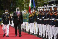 United States Defense Secretary Lloyd Austin, second left, views the military honor guard at Camp Aguinaldo military camp in Quezon City, Metro Manila, Philippines, Friday, July 30, 2021. Austin is visiting Manila to hold talks with Philippine officials to boost defense ties and possibly discuss the The Visiting Forces Agreement between the US and Philippines. (Rolex dela Pena/Pool Photo via AP)