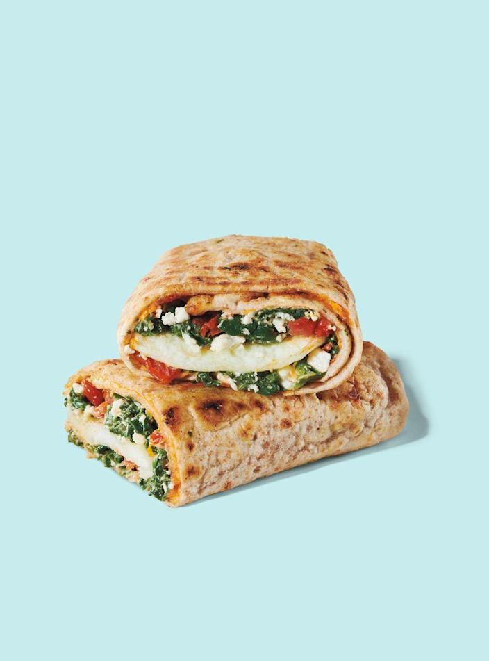"""<p><strong>Starbucks</strong></p><p>starbucks.com</p><p><a href=""""https://www.starbucks.com/menu/product/371/single?parent=%2Ffood%2Fhot-breakfast%2Fbreakfast-sandwiches-and-wraps"""" rel=""""nofollow noopener"""" target=""""_blank"""" data-ylk=""""slk:Order Now"""" class=""""link rapid-noclick-resp"""">Order Now</a></p><p><strong>Calories</strong>: 290</p><p><strong>Sodium</strong>: 840mg</p><p><strong>Total Carbohydrates</strong>: 34g</p><p><strong>Protein</strong>: 20g</p><p>This veggie-packed breakfast option is Sassos' top choice on all of Starbucks' food menu due to its significant source of protein and punch of fiber, too. """"The protein count is impressive, and I love that you're still getting satisfying bites of cheesy egg in each bite,"""" Sassos says. While the sodium count is high, it's a significant drop from other vegetarian breakfasts on the menu, including the chain's Impossible sandwich.<br></p><p><strong>Nutrition Lab Pro Tip: </strong>There's not a purely vegan breakfast sandwich available on the menu. So if you're a non-vegan seeking out a plant-based option for a potential health halo, this wrap is your best bet! </p>"""