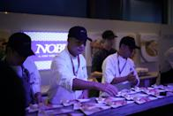 Chefs preparing canapes at Nobu's pop-up at Singapore F1. (PHOTO: Singapore GP)