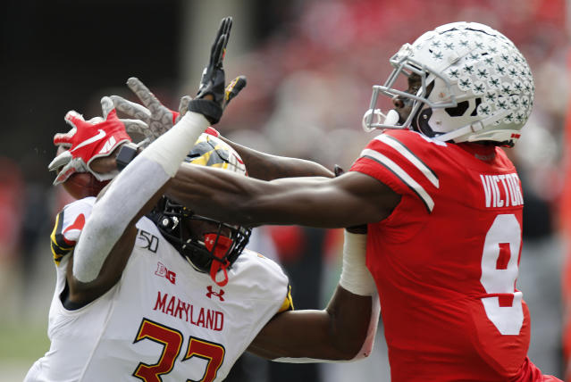 Maryland defensive back Deonte Banks, left, interferes with Ohio State receiver Binjimen Victor during the first half of an NCAA college football game, Saturday, Nov. 9, 2019, in Columbus, Ohio. Banks was penalized on the play. (AP Photo/Jay LaPrete)