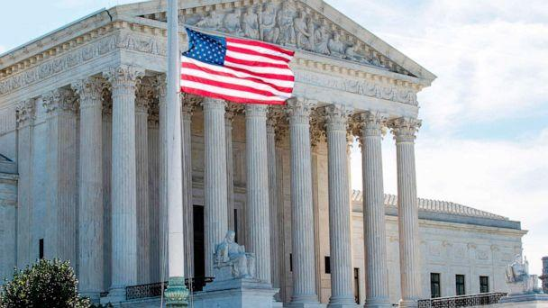 PHOTO: The US flag flies at half-staff outside of the Supreme Court in memory of Associate Justice Ruth Bader Ginsburg, in Washington on Sept. 19, 2020. (Jose Luis Magana/AFP via Getty Images)