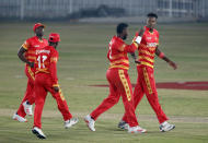 Zimbabwe's pacer Blessing Muzarabani, right, celebrates with teammates after taking the wicket of Pakistani batsman Khushdil Shah in super over during their 3rd one-day international cricket match at the Pindi Cricket Stadium, in Rawalpindi, Pakistan, Tuesday, Nov. 3, 2020. (AP Photo/Anjum Naveed)